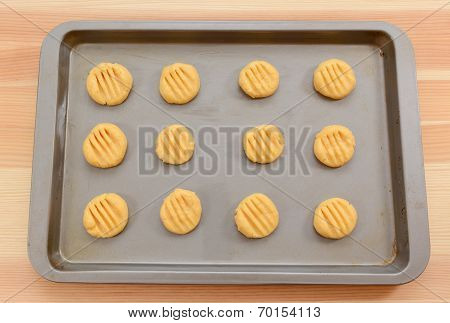 Balls Of Biscuit Dough Marked With A Fork