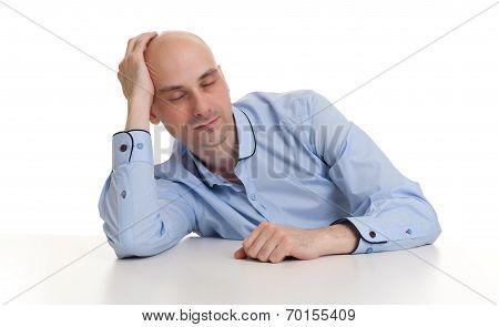 Man Sleeping On A Desk