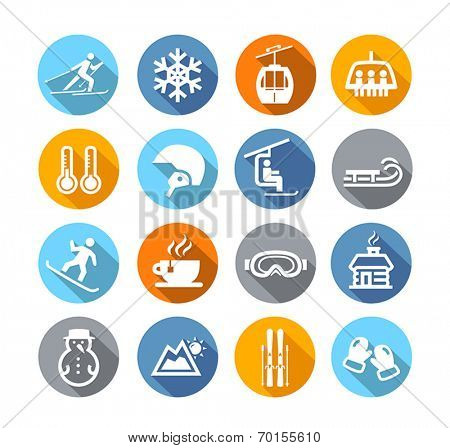 Collection of winter icons representing skiing and other winter outdoor activities in flat design style