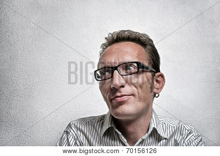 Close up portrait quit satisfied man with eyeglasses looking left and up with flirty flattery smile