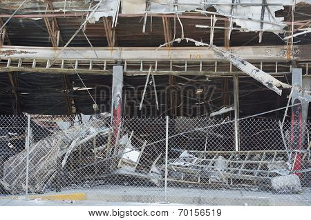 FERGUSON, MO/USA  AUGUST 15, 2014: Destroyed Quick Trip building with protective fence