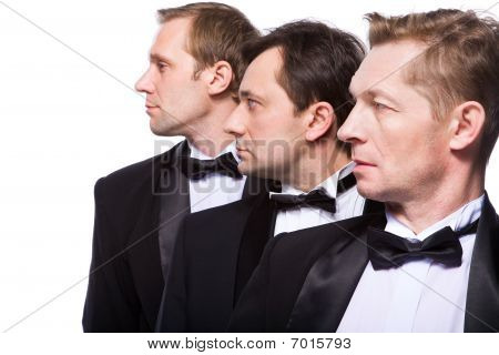 Three Gentlemen On A White Background