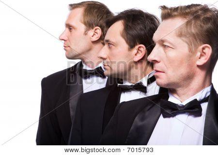 Three Gentlemen On A White Background