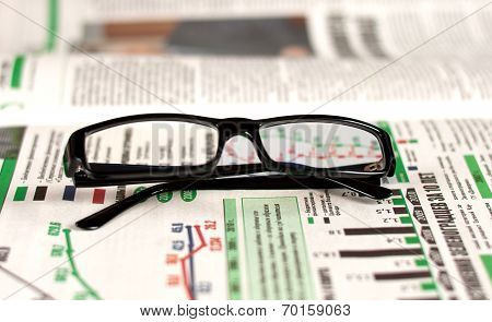 Eyeglasses Lying Around Newspapers