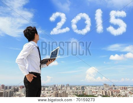 Business Man Look To 2015 Cloud
