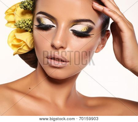Portrait Of Beautiful Brunette With Bright Makeup And Headband