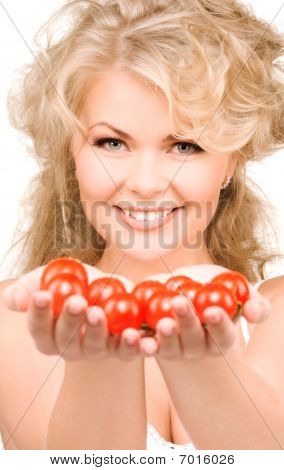 Young Beautiful Woman With Ripe Tomatoes