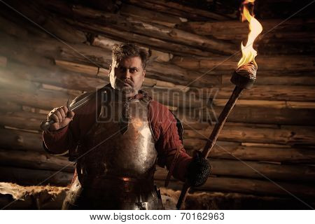 Medieval Knight In The Armor With The Sword And Flame