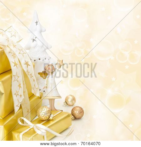 Golden Wrapped Christmas Presents With An Angel On Wooden Background.
