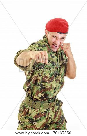 Angry Military Soldier In Uniform And Cap Hitting With Fist