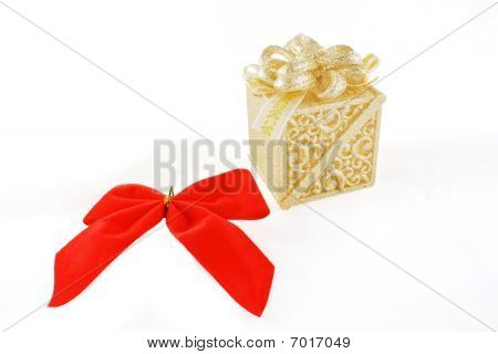 Shiny gift box and red flake over white