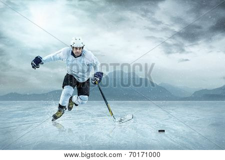 Ice hockey player on the ice, outdoor.