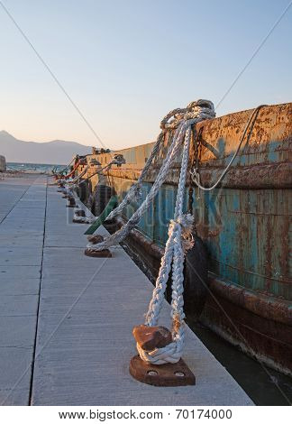 Old Sisal Ropes On A Old Rustic Cargo Boat In The Port.