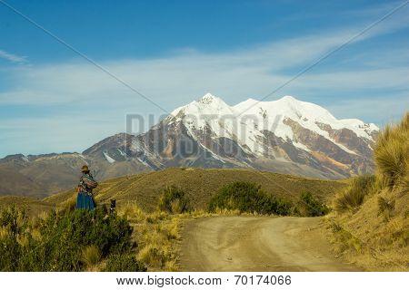Bolivian Cholita Resting Near The Road