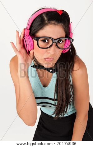 Cute Nerdy Girl Listening To Music Whilst Looking At Camera. Looking Worried.