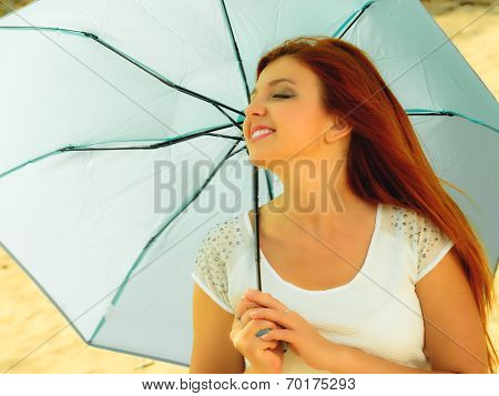 Beautiful Redhaired Girl With Umbrella On Beach.