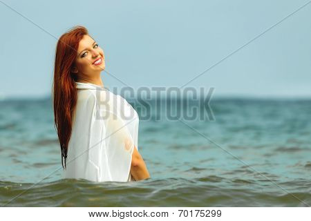 Vacation. Girl In Water Having Fun On The Sea.