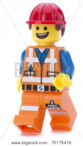 Ankara, Turkey - March 15, 2014 :  Lego movie minifigure character Emmet walking isolated on white background.