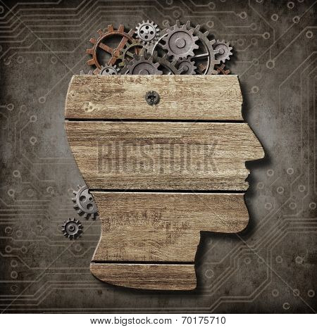 Open brain model made from wood, rusty metal gears and cogs