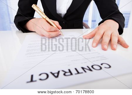 Businesswoman Signing Contract Paper