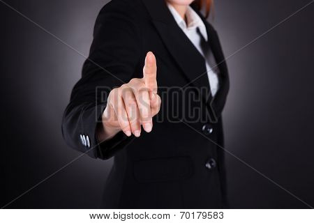 Businesswoman Touching Imaginary Screen