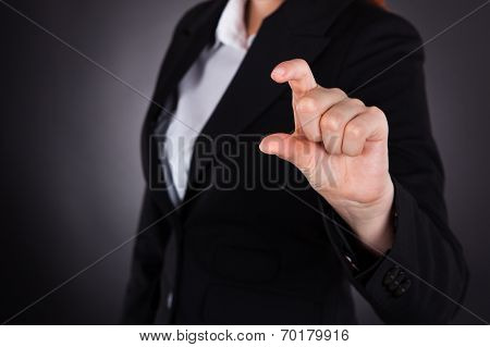 Businesswoman Showing Small Amount Gesture
