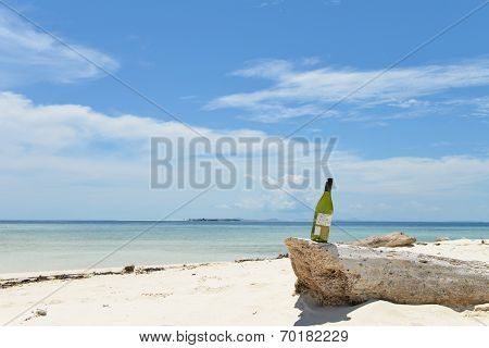 bottle of wine on beach