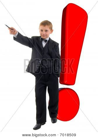 Smiling Young Boy And Red Exclamation Mark. Studio Shoot Over White Background.