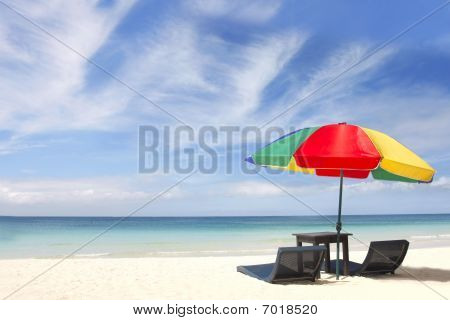 Umbrella And Chairs On Sand Beach
