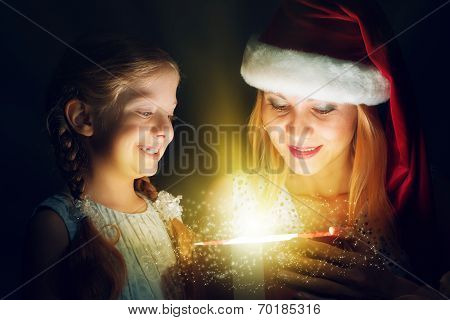mother and daughter opened a box with a gift
