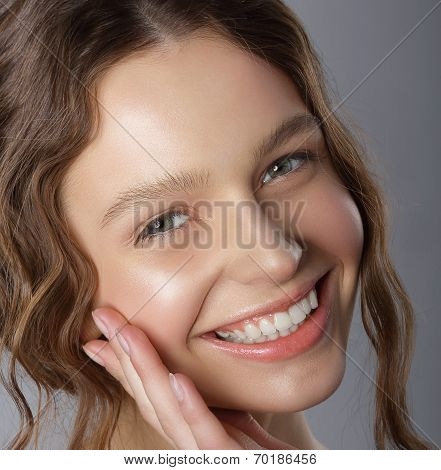 Sincere Winning Smile. Face Of Happy Pleasant Young Woman