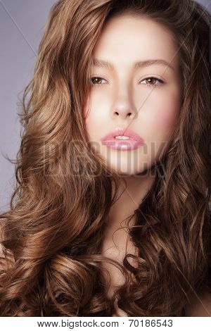 Purity. Haircare. Woman With Frizzy Brown Healthy Hair