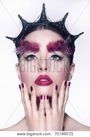 Creative Concept. Woman With Fancy Headwear And Red Make-up