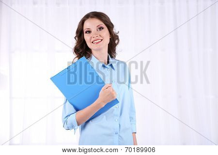 Young business woman in room