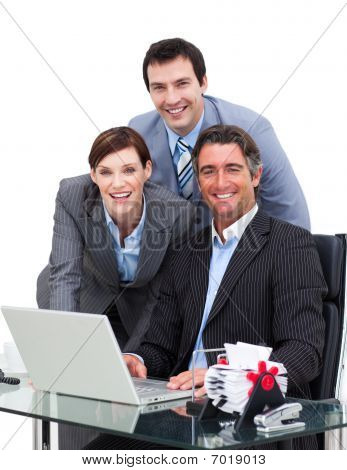 Merry Business Team Working At A Computer