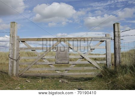 Gate With Blank Sign.