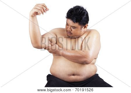 Fat Man Holding His Flabby Biceps 1
