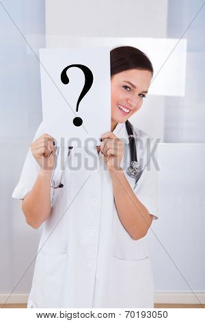 Doctor Holding Question Mark Sign In Hospital