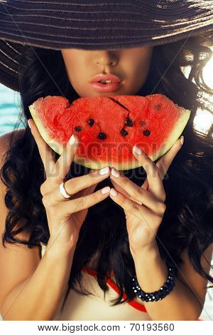 Sexy Girl With Dark Hair Eating Watermelon