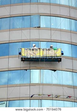 Washing Windows Of An Office Building