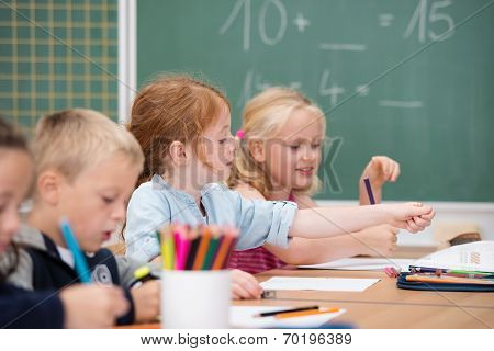 Young Girls In School Working On A Class Project