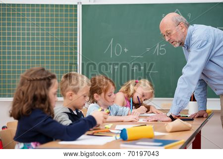 Elderly Male Teacher In Primary School