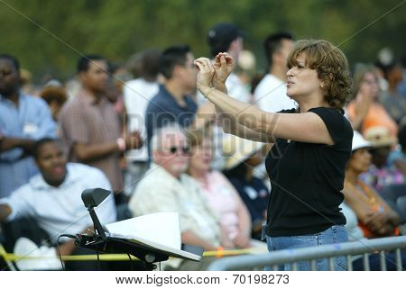 NEW YORK - JUNE 25:  A sign language interpreter gestures during the Greater New York Billy Graham Crusade in Flushing Meadow Corona Park June 25, 2005 in the Queens borough of New York City.
