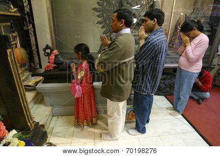 NEW YORK - JANUARY 1:  Hindu faithful pray for Sri Lankan tsunami victims at the Hindu Ganesh Temple January 1, 2005 in Flushing, NY.