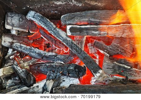 Flame Over Hot Wood-burning Coals