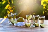 image of crystal salt  - gold tequila with salt and lime on old wooden table - JPG
