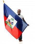 stock photo of tween  - A pretty tween girl proudly holding her Haitian flag - JPG