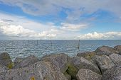 picture of dike  - Clouds over a dike in a lake - JPG