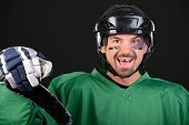 foto of toothless smile  - Funny hockey player smiling bruise around the eye - JPG