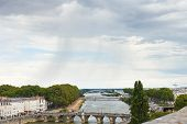 stock photo of anjou  - view of bridges Pont de Verdun and Pont de Haute Chaine on La Maine river in Angers France in rainy day - JPG